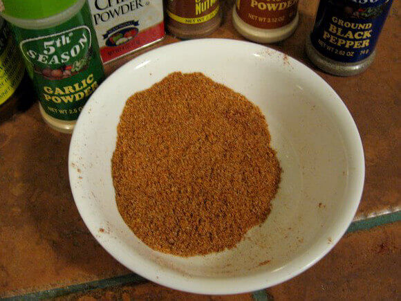 Dry Rub Ingredients Behind Bowl Of Mixed Rub