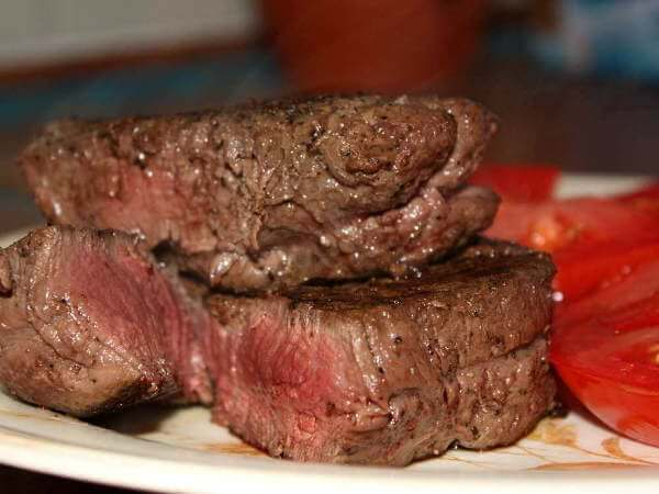 Grill Smoked Filet Mignon Steaks On Plate With Tomatoes