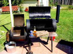 Wood Fired Oklahoma Joe Horizontal Pit Smoker With a Bottle of Miller High Life At The Ready
