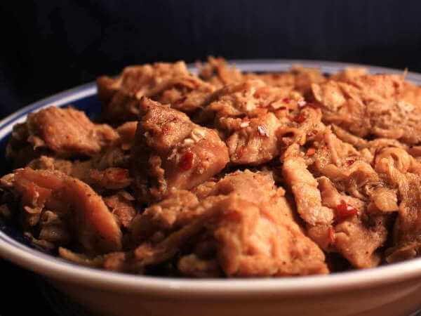 Pulled Pork In a Little Bowl, Seasoned With Red Pepper Flake Seasoned Vinegar Sauce