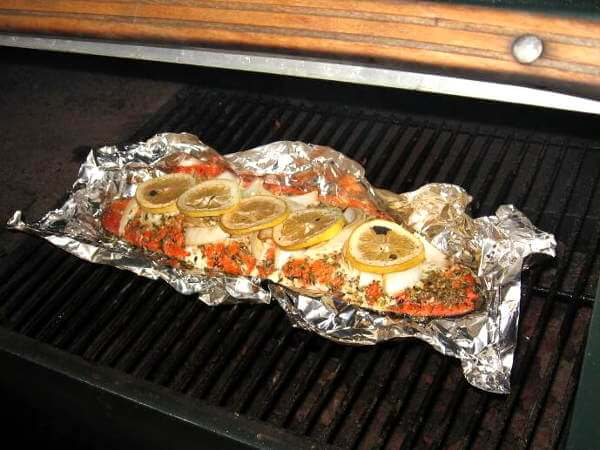 Salmon Fillet, Topped With Spices and Lemon Slices, Cooking In a Traeger Smoker