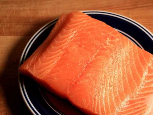 Raw Atlantic Salmon Fillet On Blue Bordered Plate
