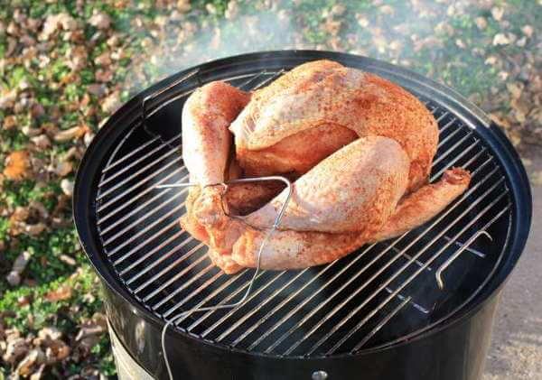 Raw, Seasoned Whole Turkey On a Weber Smokey Mountain Cooker