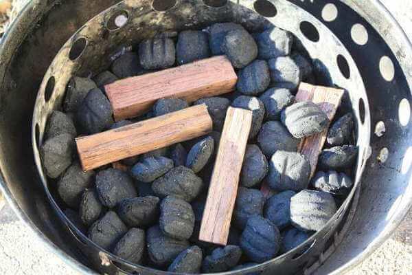 Method Of Adding Smoker Wood To The Weber Smokey Mountain Cooker