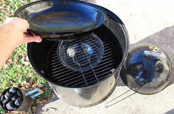 Placing The Water Pan In My Weber Smokey Mountain