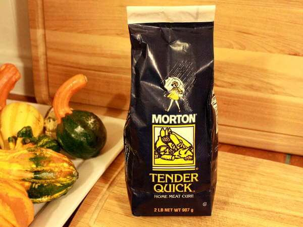 Bag of Morton Tender Quick Curing Mix Next To Decorative Gourds