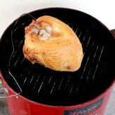 A Whole Turkey Breast Being Smoked In an Electric Water Smoker