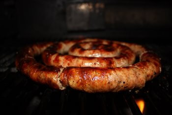 Homemade Sausage Cooking Gently On the Grill