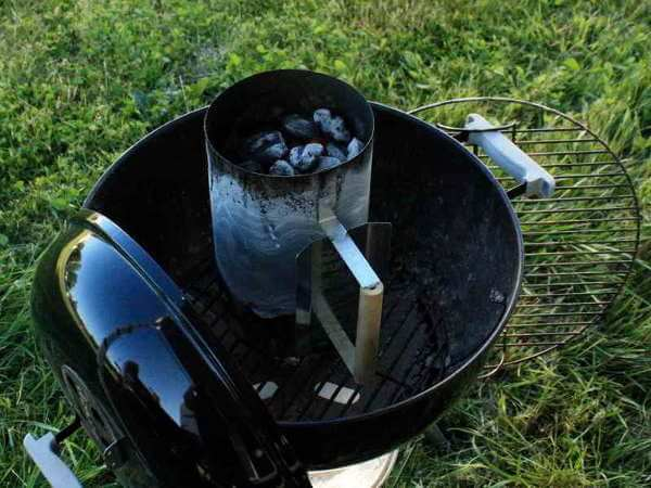 Weber Kettle Grill With Charcoal Chimney Positioned on Lower Grate